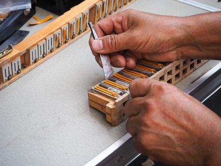 Old man repairing the reed blocks of a vintage accordion, Beijing, China Фото со стока