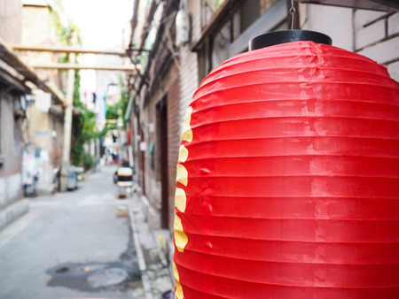 Chinese red lantern hanging in front of old houses in the French concession in the city center of Tianjin