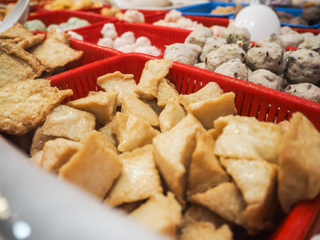 Siu mai, stinky tofu and fish balls in small containers sold at a street food stall in central Hong Kong
