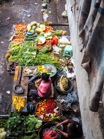 Bali, Indonesia - April 2017: Women selling fresh food at the market in central Ubud