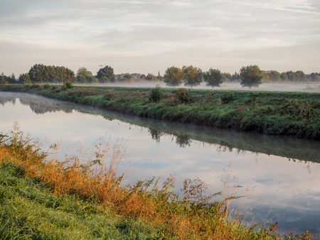 Beautiful September sunrise over the Mechels Broek nature park and the river Dijle, just outside of Mechelen, Belgium