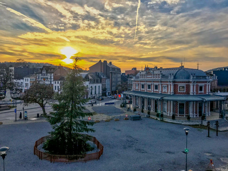 The main square of the Belgian town Spa, with a large christmas tree during sunset. Spa is famous for its mineral springs a&nd racing circuit. 写真素材