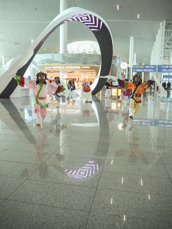 South Korea- October 2018: Dancers performing a traditional Korean mask dance in the recently opened Incheon International Airport terminal 2 Editöryel