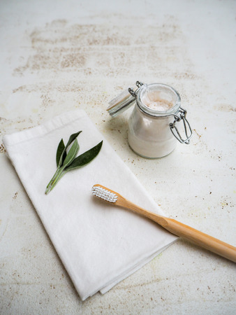DIY homemade vegan toothpaste in a small glass jar following a zero waste and plastic free lifestyle Stock fotó