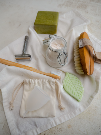 Set of eco friendly, plastic free toiletries and healthcare products such as bamboo toothbrush and body brush, reusable menstrual cup and metal razor Stock fotó