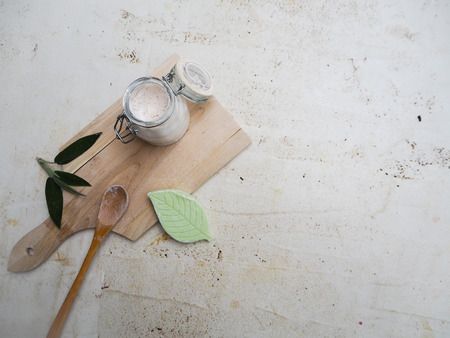 Homemade vegan deodorant in a glass jar on a bamboo board and white background, representing a zero waste lifestyle Stock fotó