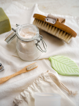 Set of eco friendly toiletries and bathroom products such as bamboo toothbrush, body brush and homemade toothpaste