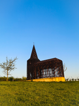 Steel see-through church in Borgloon (Hesbaye, Belgium), known as the art project Reading between the lines on a sunny day