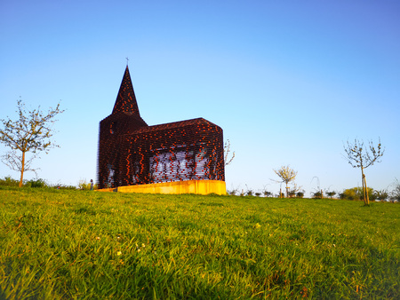 Steel see-through church in Borgloon (Hesbaye, Belgium), known as the art project Reading between the lines on a sunny day Banco de Imagens
