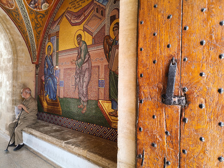 August 2018 - Cyprus: Entrance to the Greek orthodox Kykkos monastery with beautiful mosaic art depicting religious stories Stock fotó - 127150623