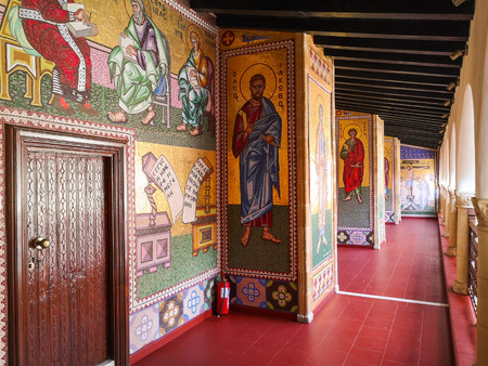 August 2918 - Cyprus: Hallway full with stunning mosaic religious artworks in the Greek orthodox Kykkos monastery of the Holy Virgin