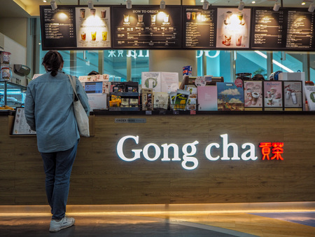 March 2019 - South Korea: Young Asian woman making an order at a Taiwanese Gong Cha bubble tea franchise shop famous for its pearl milk tea Sajtókép
