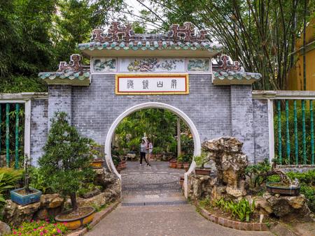 MACAU, CHINA - NOVEMBER 2018: Entrance to the Lou Lim Leoc public garden and park in the city center Sajtókép