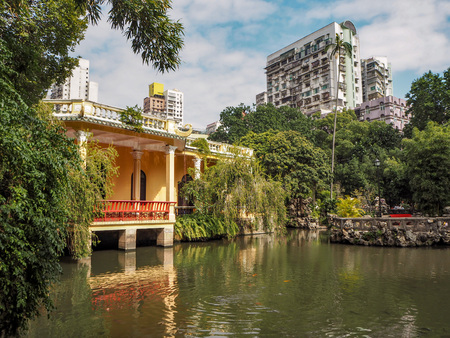 MACAU, CHINA - NOVEMBER 2018: The QIngcao hall in the middle of the Lou Lim Leoc public garden in the city center, overlooking the lotus pond Sajtókép
