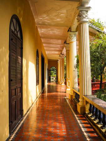 MACAU, CHINA - NOVEMBER 2018: The long corridor of the Qingcao hall in the Lou Lim Leoc public garden, a combination of Western and Chinese style