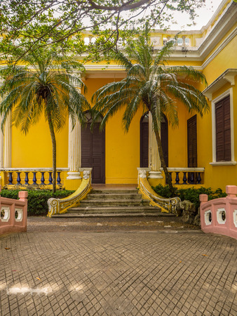 MACAU, CHINA - NOVEMBER 2018: The vibrant yellow Qingcao hall of the Lou Lim Leoc public garden and park Stock fotó - 127150671