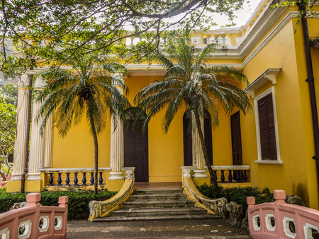 MACAU, CHINA - NOVEMBER 2018: The vibrant yellow Qingcao hall of the Lou Lim Leoc public garden and park
