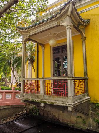 MACAU, CHINA - NOVEMBER 2018: The vibrant yellow Qingcao hall of the Lou Lim Leoc public garden and park Stock fotó - 127150673