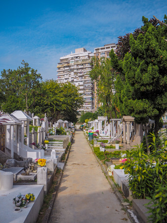 MACAU,CHINA - NOVEMBER 2018: The Saint Michael's chapel and cemetery in the city center with graves of catholic Macau Portuguese and Chinese Stock fotó - 127150825