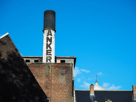 October 2018 - Mechelen, Belgium: Old chimney of the beer brewery Het Anker, producer of the beer Golden Carolus Stock fotó - 127151260