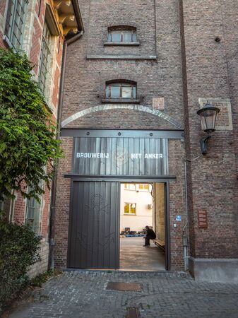 October 2018 - Mechelen, Belgium: Entrance with large wooden gate to the berwery Het Anker in the beguinage in the city center
