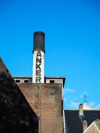 October 2018 - Mechelen, Belgium: Old chimney of the beer brewery Het Anker, producer of the beer Golden Carolus Stock fotó - 127151267