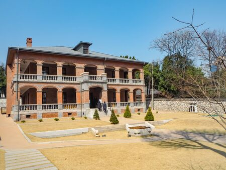 March 2019 - Seoul, South Korea: Jungmyeongjeon hall, a two-story red brick Western style building in Deoksugung Palace, now an exhibition space Stock fotó - 127151315