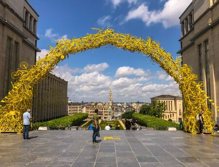 July 2019 - Brussels, Belgium: Arch on the Mont des Arts made of yellow bicycles on the occasion of the start of the 2019 Tour de France Stock fotó - 127151451