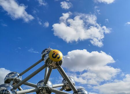 July 2019 - Brussels, Belgium, The Atomium with one yellow atom for the occasion of the start of the 2019 Tour de France in Brussels Stock fotó - 127151453