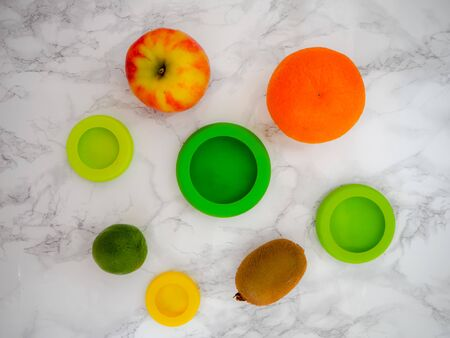 Variety of fruits and colorful ecological silicone food wraps for preserving cut foods for a zero waste lifestyle Stock fotó - 131910655