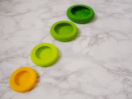 Variety of colorful ecological silicone food wraps for preserving cut food in a zero waste lifestyle