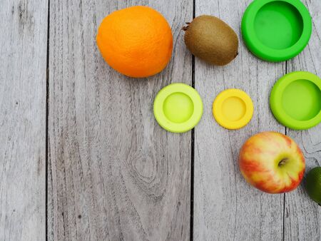 Multiple reusable silicone food wraps for cut fruits in order to reduce food waste in a zero waste and plastic free lifestyle Stock fotó - 131909631