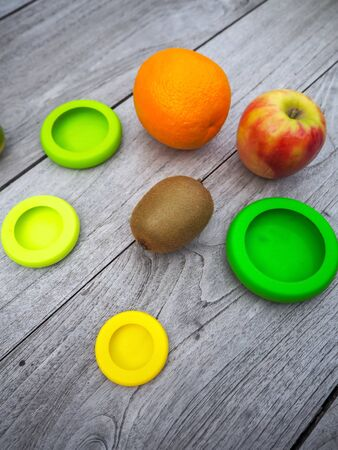 Multiple reusable silicone food wraps for cut fruits in order to reduce food waste in a zero waste and plastic free lifestyle Stock fotó - 131910022