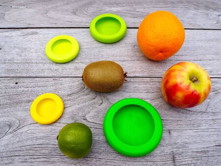 Multiple reusable silicone food wraps for cut fruits in order to reduce food waste in a zero waste and plastic free lifestyle Stock fotó - 131909674
