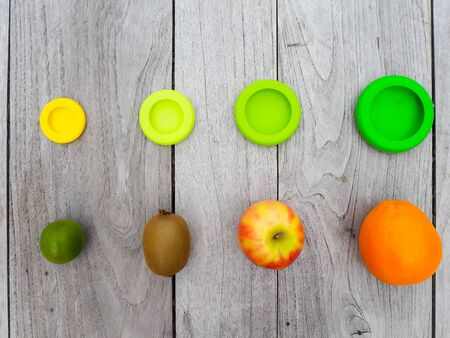 Multiple reusable silicone food wraps for cut fruits in order to reduce food waste in a zero waste and plastic free lifestyle Stock fotó - 131909942