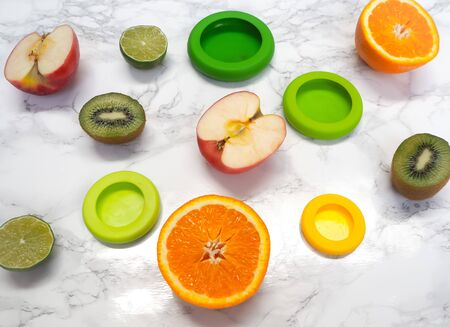 Variety of cut fruits and colorful reusable silicone food wraps for reducing food waste in a zero waste lifestyle Stock fotó - 131910306