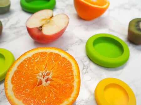 Variety of cut fruits and colorful reusable silicone food wraps for reducing food waste in a zero waste lifestyle Stock fotó - 131910321