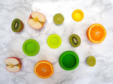 Variety of cut fruits and colorful reusable silicone food wraps for reducing food waste in a zero waste lifestyle Stock fotó - 131909887