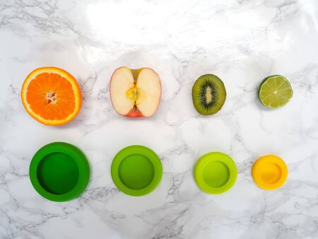 Variety of cut fruits and colorful reusable silicone food wraps for reducing food waste in a zero waste lifestyle Stock fotó - 131910359