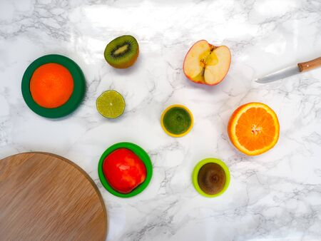 Sliced fruits with colorful reusable silicone food wraps for reducing food waste and food loss in a zero waste lifestyle Stock fotó - 132460943
