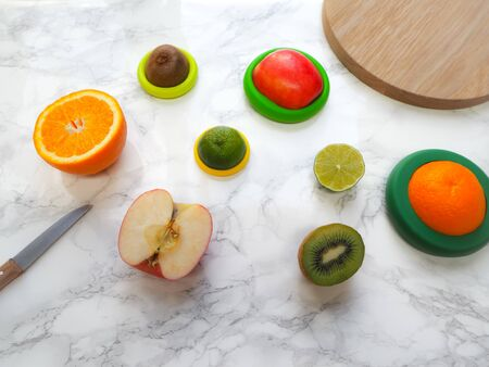 Sliced fruits with colorful reusable silicone food wraps for reducing food waste and food loss in a zero waste lifestyle Stock fotó - 132460693