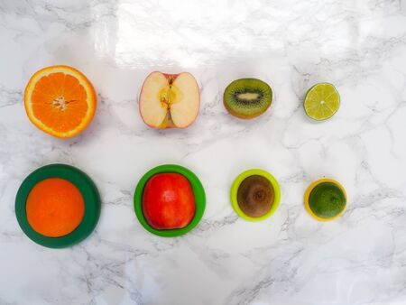 Sliced fruits in colorful reusable silicone food wraps for reducing food waste and food loss in a zero waste lifestyle Stock fotó - 132464600