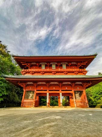The vibrant red Daimon gate functioning as the entrance to the famous pilgrimage town Koyasan in Wakayama, Kansai, Japan