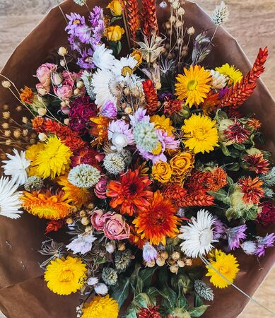 Vibrant dried flower arrangement in red and yellow Stock fotó