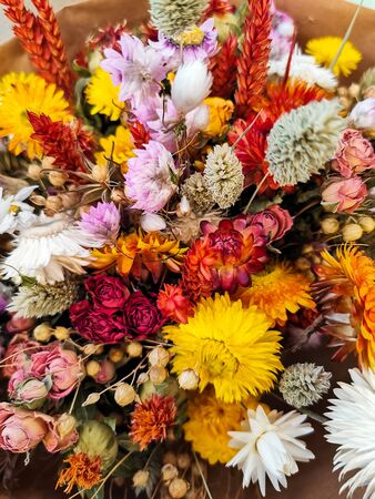 Vibrant dried flower bouquet in red and yellow Stock fotó
