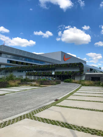 HAM, BELGIUM - February 2020: Nike's newest EMEA distribution center, Court, with a large green exterior