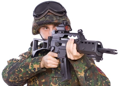 one soldier with the gun in the hands on a white background Banque d'images