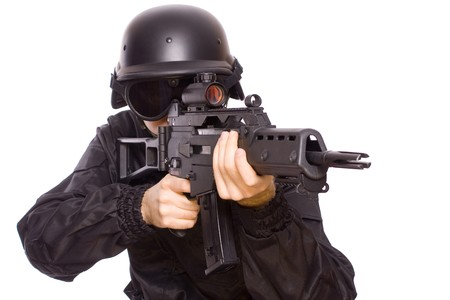 one soldier with the gun in the hands on a white background Stock Photo