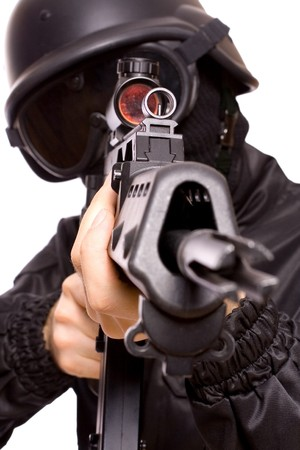 airsoft: one soldier with the gun in the hands on a white background Stock Photo