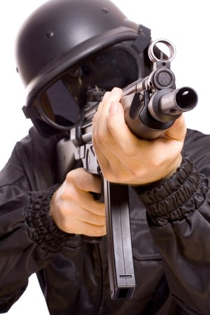airsoft gun: one soldier with the gun in the hands on a white background Stock Photo